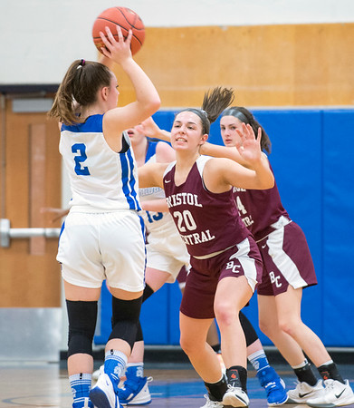 01/27/20 Wesley Bunnell | StaffrrBristol Central girls basketball was defeated in an away game at Lewis Mills on Monday night. Gwenyth Torreso (20) on defense.