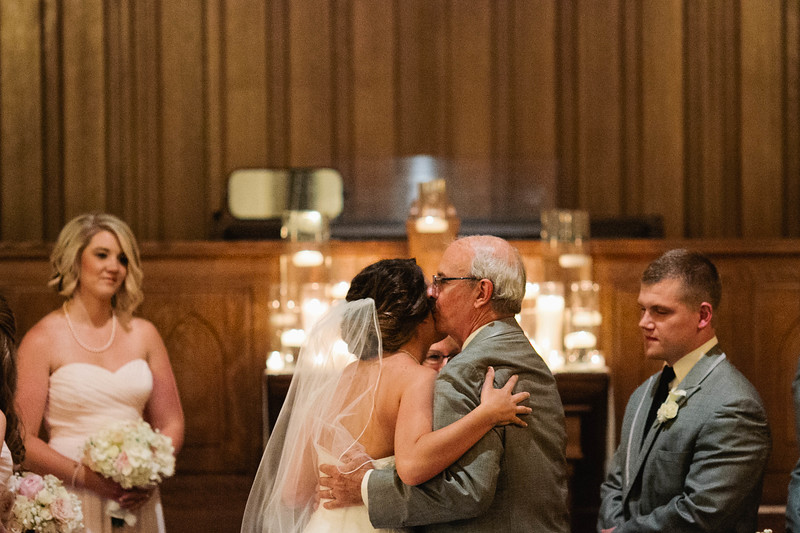 dad gives bride away