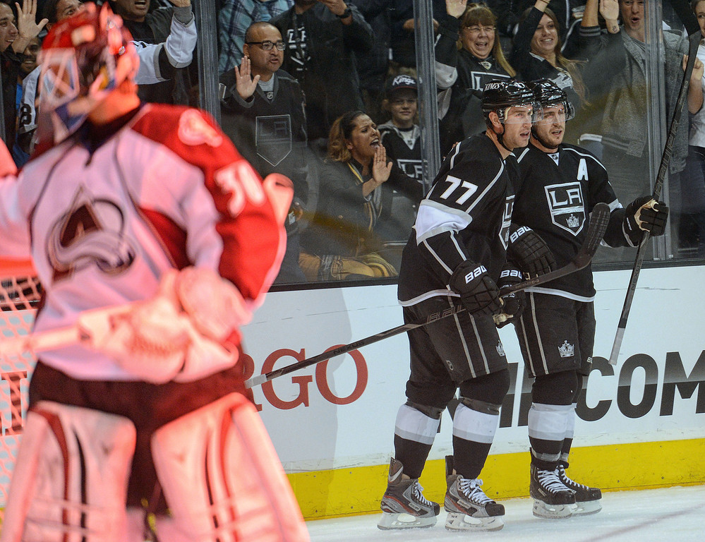 . The Kings\' Mike Richards #10 congratulates Jeff Carter #77 after Carter scored on Avalanche goalie Sami Aittokallio during their game at the Staples Center in Los Angeles Thursday, April 11, 2013.(Hans Gutknecht/Staff Photographer)