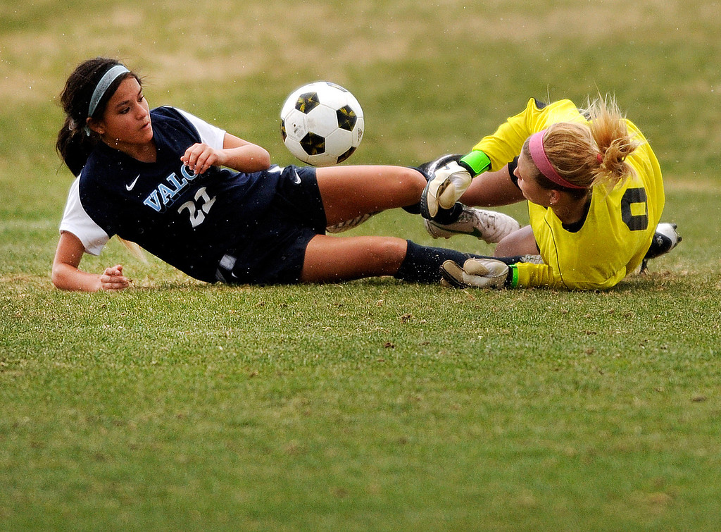 . PARKER, CO. - APRIL 2: Golden goalkeeper Jordyn Komoras (0) came out to stop Valor midfielder Amanda Lopez (22) in the first half. The Valor Christian High School girl\'s soccer team defeated Golden 4-1 Wednesday night, April 3, 2013.  Photo By Karl Gehring/The Denver Post)