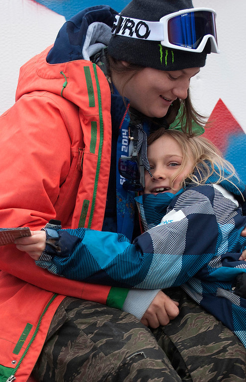 """. Kayla Rice/Reformer                                 Elaina Krusiewski, 8, of Dover hugs Mount Snow athlete and Olympic silver medalist Devin Logan after getting her autograph before the \""""Devin Day\"""" parade and celebration in Dover on Saturday."""