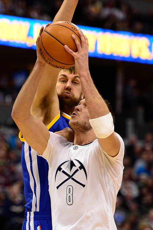 . DENVER, CO - JANUARY 13: Danilo Gallinari (8) of the Denver Nuggets goes up for the easy shot but is defend by Andrew Bogut (12) of the Golden State Warriors during the first half at the Pepsi Center on January 13, 2016 in Denver, Colorado.  (Photo by Brent Lewis/The Denver Post)