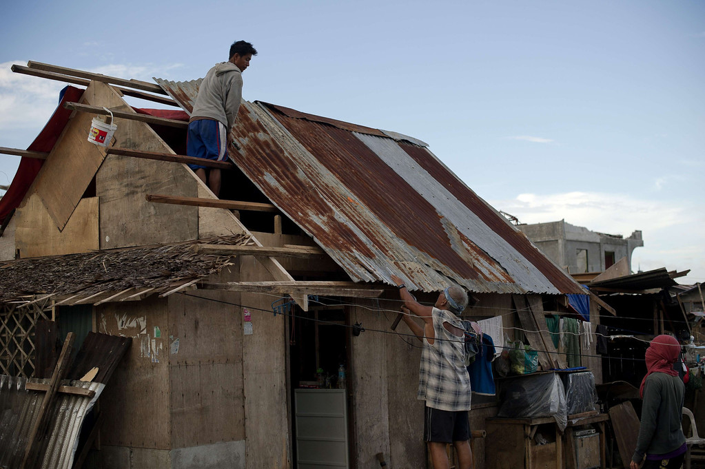 . Typhoon survivors build a temporary shack in Palo on November 21, 2013. AFP PHOTO/ Nicolas  ASFOURI/AFP/Getty Images