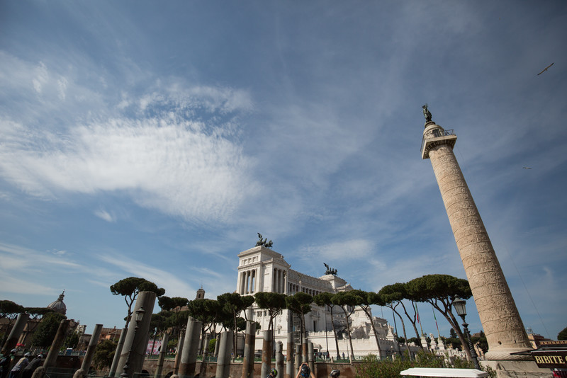 Trajan's Column (c. 113 AD) in the foreground, and the Altare della Patria (Altar of the Fatherland or Monumento Nazionale a Vittorio Emanuele II) in the background.