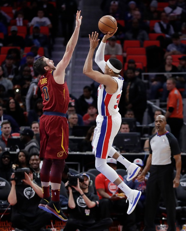 . Detroit Pistons forward Tobias Harris (34) shoots over Cleveland Cavaliers forward Kevin Love (0) during the second half of an NBA basketball game, Monday, Nov. 20, 2017, in Detroit. (AP Photo/Carlos Osorio)