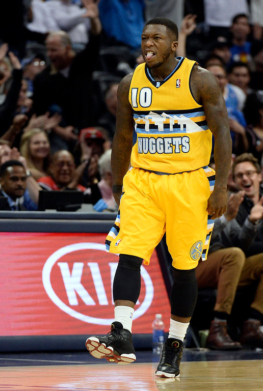 . Denver Nuggets point guard Nate Robinson (10) sticks his tongue out after hitting a three pointer during fourth quarter against the Chicago Bulls November 21, 2013 at Pepsi Center. (Photo by John Leyba/The Denver Post)