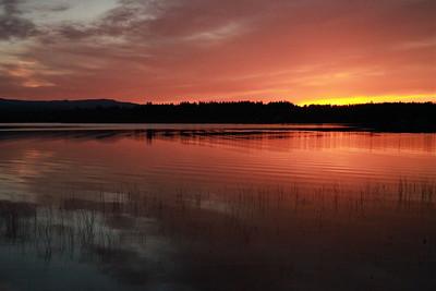 Sunset and Moonrise over Dragon Lake