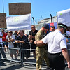 A military photographer, believed to be the British Forces official command photographer, is led back into the naval base by Gibraltar Defence Police Inspector as his presence raised tensions.