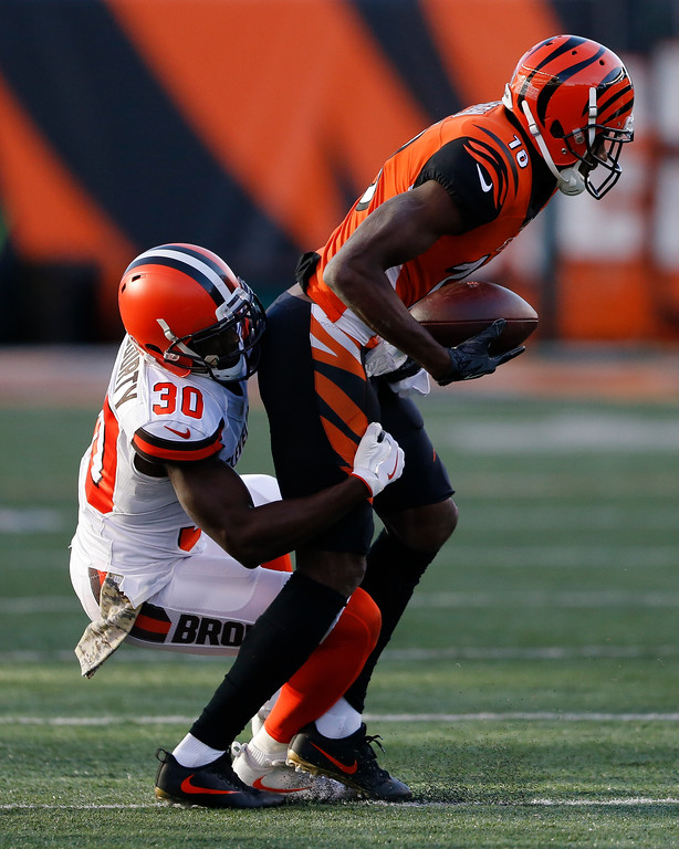 . Cincinnati Bengals wide receiver A.J. Green (18) is tackled by Cleveland Browns cornerback Jason McCourty (30) in the second half of an NFL football game, Sunday, Nov. 26, 2017, in Cincinnati. (AP Photo/Gary Landers)
