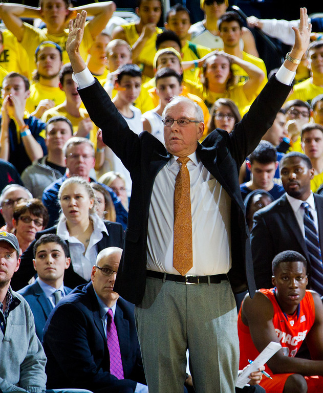 . Syracuse head coach Jim Boeheim holds up his hands in the air courtside in the second half of an NCAA college basketball game against Michigan at Crisler Center in Ann Arbor, Mich., Tuesday, Dec. 2, 2014. Michigan won 68-65. (AP Photo/Tony Ding)