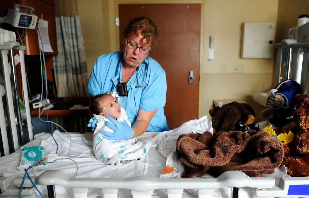 . Respiratory Therapist, Denise Gilbert does respiratory therapy with 5-week-old Jeremiah Damian, Wednesday, August 29, 2012, at Rocky Mountain Children\'s Hospital at Presbyterian St. Luke�s Medical Center in Denver. Jeremiah Damian just recently got out of the ICU at the hospital with whooping cough. Cases of whooping cough are on the rise in Colorado and around the nation, and public health officials worry anew about vaccine refusers and their effect on the rest of the population. RJ Sangosti, The Denver Post