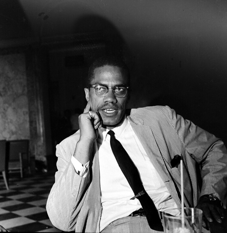 ". Malcolm X speaks at a news conference in the Hotel Theresa on 125th St. and Seventh Ave., in New York City, May 21, 1964.  The black nationalist leader, who has just returned from Africa, says he wants to form a united Afro-American front to help bring the plight of the ""Afro-American negroes\"" before the United Nations.  After his pilgrimage to Mecca in April, he has changed his name to El-Hajj Malik El-Shabazz.  (AP Photo)"