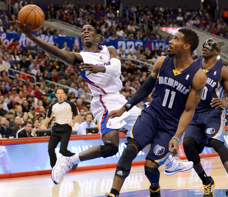 . Los Angeles Clippers\' Darren Collison puts up a shot against Mike Conley of the Memphis Grizzlies during the first half Monday, Nov. 18, 2013, in Los Angeles.(Andy Holzman/Los Angeles Daily News)
