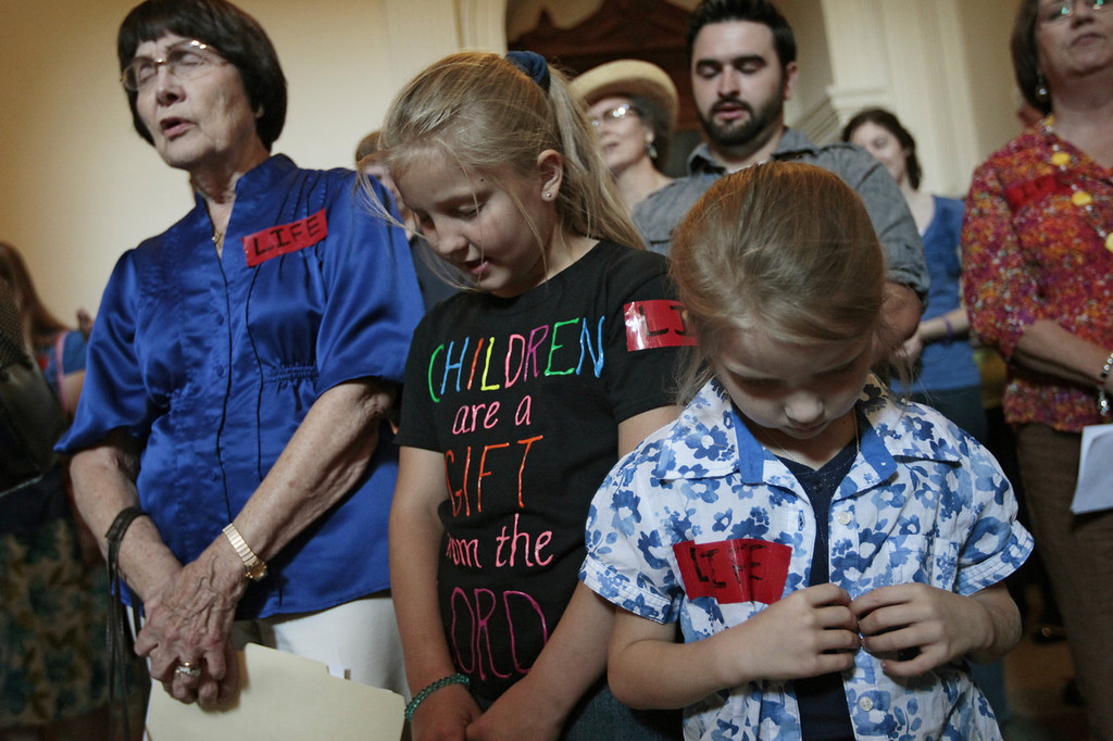 . Pro-life supporters pray in the Texas State capitol on July 1, 2013 in Austin, Texas. This is first day of a second legislative special session called by Texas Gov. Rick Perry to pass a restrictive abortion law through the Texas legislature. The first attempt was defeated after opponents of the law were able to stall the vote until after the first special session had ended.  (Photo by Erich Schlegel/Getty Images)