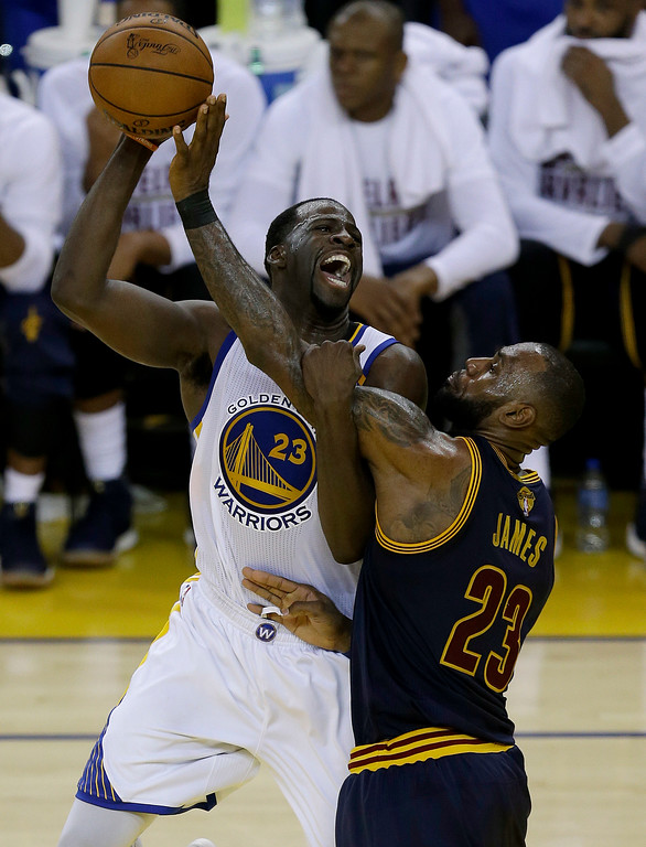 . Golden State Warriors forward Draymond Green, left, shoots against Cleveland Cavaliers forward LeBron James during the second half of Game 1 of basketball\'s NBA Finals in Oakland, Calif., Thursday, June 1, 2017. (AP Photo/Ben Margot)