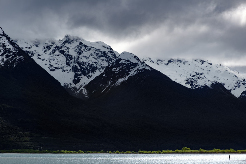 Solitary figure on shore of Lake Wakatipu, Glenorchy, South Island, New Zealand