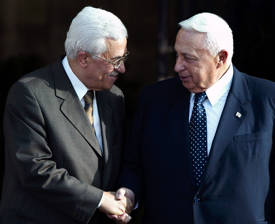 . Photograph dated 01 July 2003 of Palestinian Prime Minister Mahmoud Abbas (L) shaking hands with then Israeli Prime Minister Ariel Sharon at Sharon\'s offices in Jerusalem, Israel.   EPA/JIM HOLLANDER