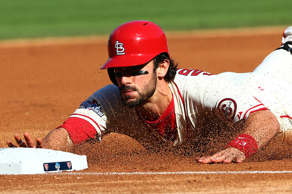 . ST LOUIS, MO - OCTOBER 12:  Matt Carpenter #13 of the St. Louis Cardinals slides into third on a first inning triple against the Los Angeles Dodgers during Game Two of the National League Championship Series at Busch Stadium on October 12, 2013 in St Louis, Missouri.  (Photo by Elsa/Getty Images)