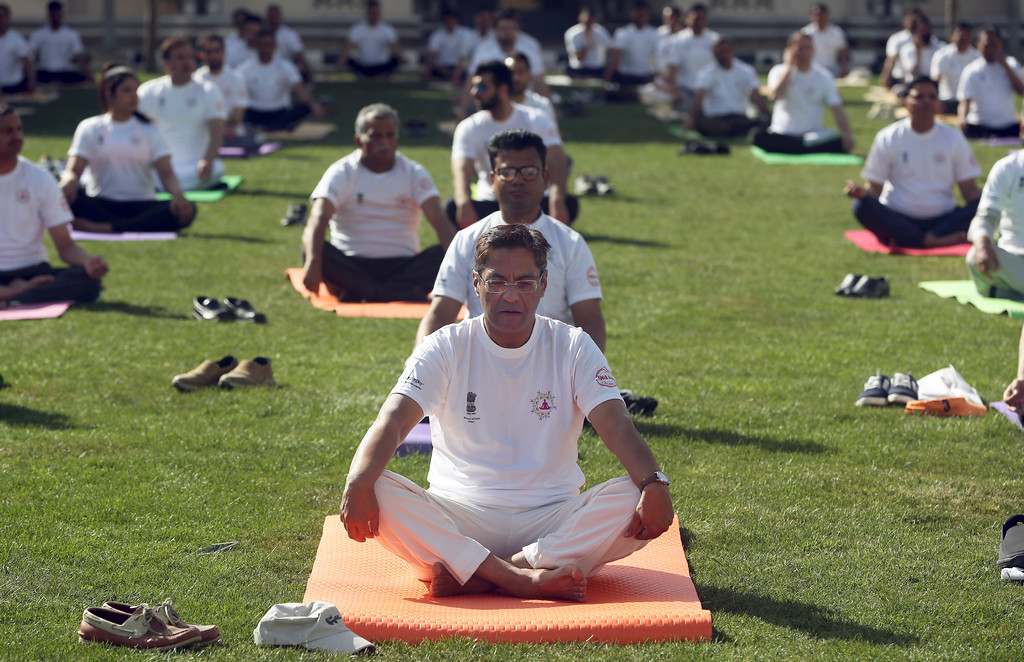 . Indian Ambassador, Manpreet Vohra, center, Afghans, and foreigners perform yoga to mark International Yoga Day at the Indian Embassy, in Kabul, Afghanistan,Wednesday, Jun 21, 2017. Thousands of yoga enthusiasts took part in mass yoga programs to mark International Yoga Day throughout the world. (AP Photo/Massoud Hossaini)