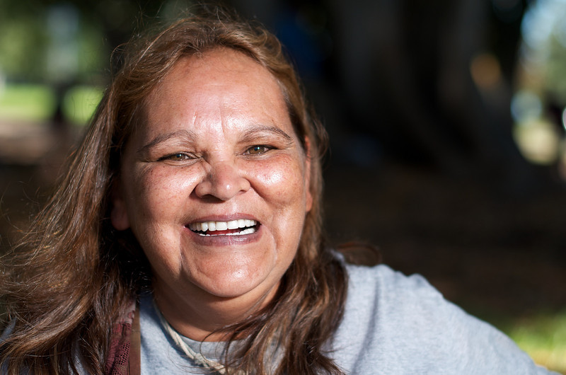 Aboriginal Woman smiling while looking at the camera