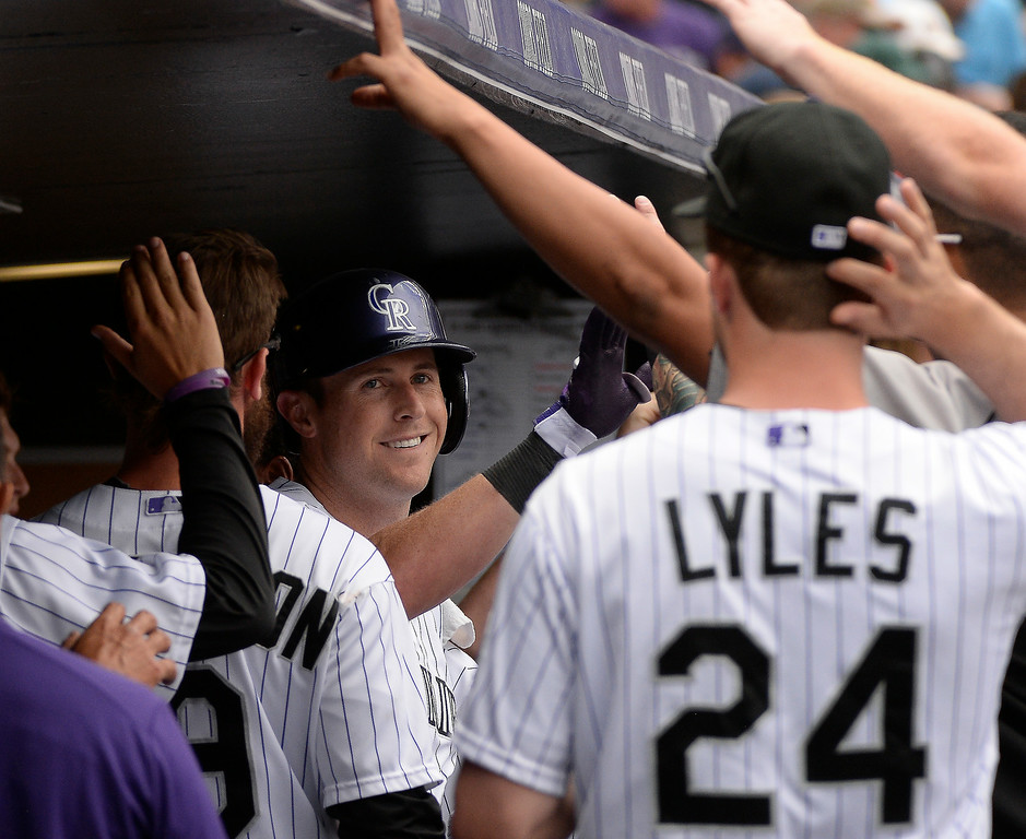 . Colorado Rockies center fielder Drew Stubbs (13) smiles int he dugout after hitting a home run in the fourth inning off of St. Louis Cardinals starting pitcher Marco Gonzales (56) June 25, 2014 at Coors Field. (Photo by John Leyba/The Denver Post)