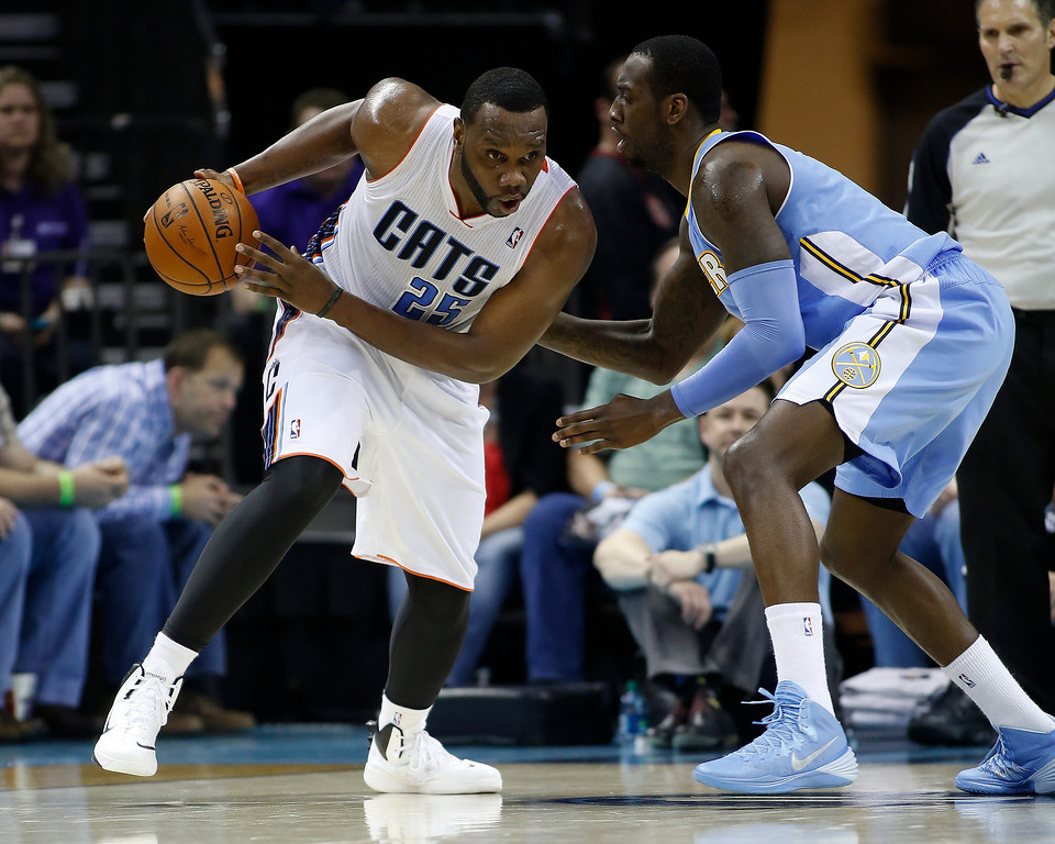 . Charlotte Bobcats center Al Jefferson, left, drives against Denver Nuggets center JJ Hickson during the second half of an NBA basketball game in Charlotte, N.C., Monday, March 10, 2014. Charlotte won 105-98. (AP Photo/Nell Redmond)