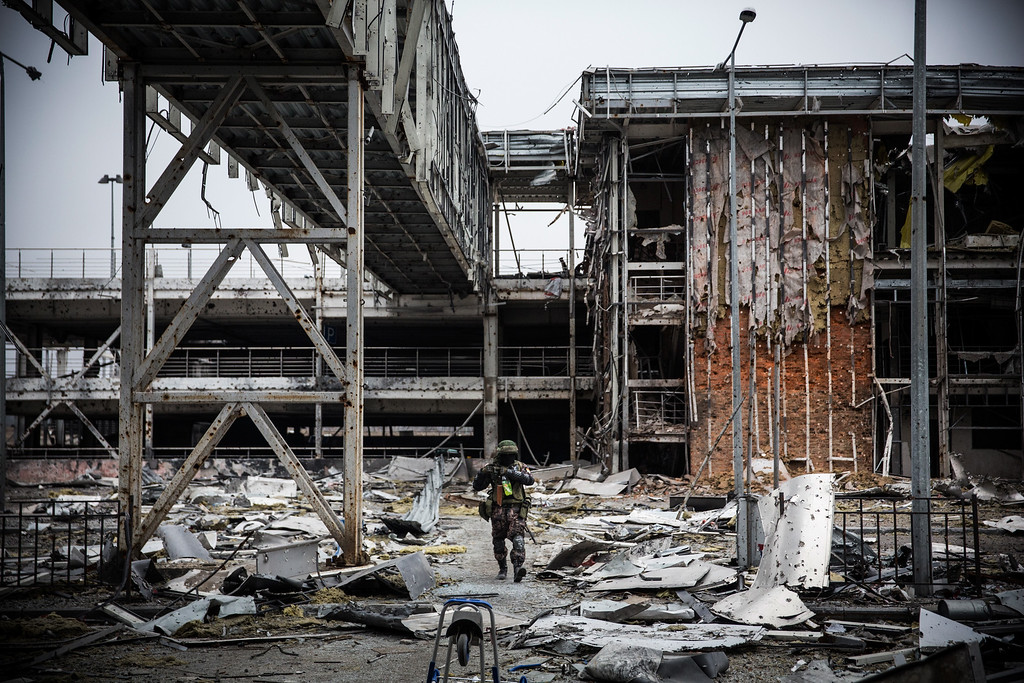 . DONETSK, UKRAINE - FEBRUARY 26:  A pro-Russian rebel walks amongst the wreckage of the destroyed Donetsk airport on February 26, 2015 in Donetsk, Ukraine. The Donetsk airport has been one of the most heavily fought over pieces of land between the Ukrainian army and pro-Russian rebels.  (Photo by Andrew Burton/Getty Images)