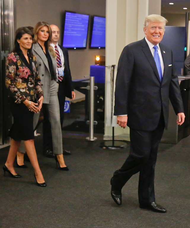 . President Donald Trump, far right, arrives with first lady Melania Trump, second from left, and U.S. United Nations Ambassador Nikki Haley, far left, for the meeting of the U.N. General Assembly, Tuesday Sept. 19, 2017 at U.N. headquarters. (AP Photo/Bebeto Matthews)