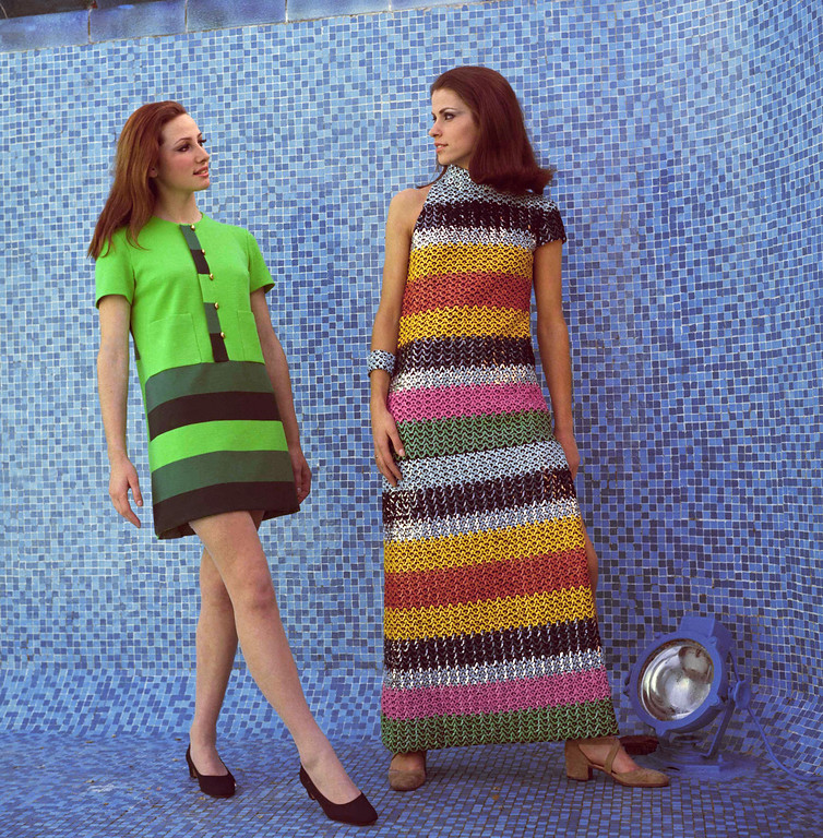 . Two dresses, by Cesare Guidi of Florence. Left, a silk evening completely embroidered with multi-colored paillettes, with one short sleeve only. Right is a ?week-end? dress in light green with horizontal stripes in darker green shades. 1967 photo. (AP Photo/Mario Torrisi)