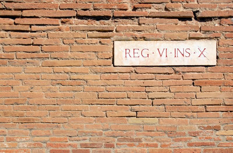 Street Sign Tablet on Brick Wall, Pompeii (Italy)