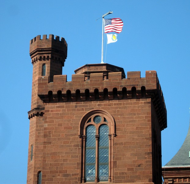 The U.S. flag and the Smithsonian Institution flag fly over the Smithsonian Institution Building (3/13/11)