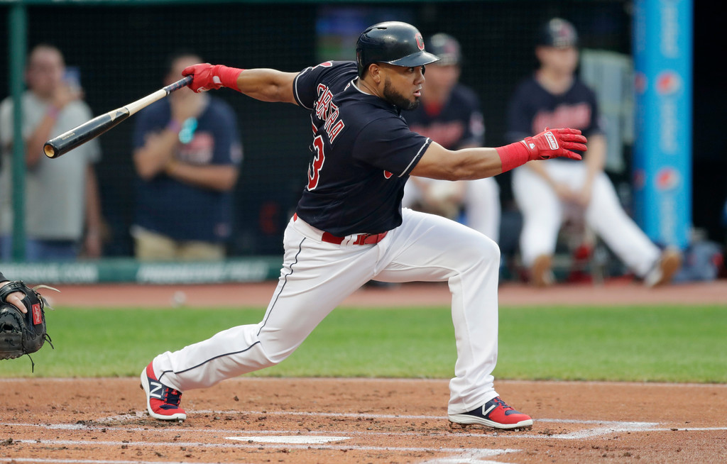 . Cleveland Indians\' Melky Cabrera grounds into a force out during the first inning of a baseball game against the Kansas City Royals, Tuesday, Sept. 4, 2018, in Cleveland. Cabrera was safe at first base and Yandy Diaz scored on the play. (AP Photo/Tony Dejak)