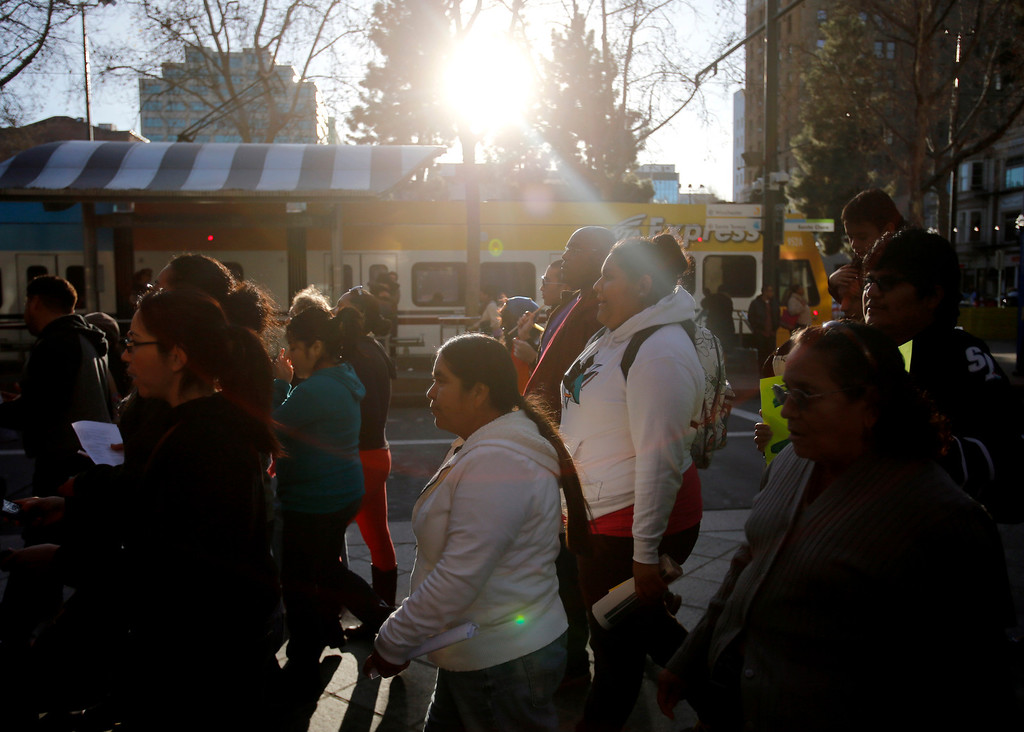 ". Protestors march south on S. 2nd St. during an ""Immigration Reform Now\"" rally in San Jose, Calif., on Thursday, Feb. 21, 2013.  They were protesting comprehensive immigration reform.  They began at Dr. Martlin Luther King, Jr. Library and ended at the Robert F. Peckham Federal Building.  (Nhat V. Meyer/Staff)"