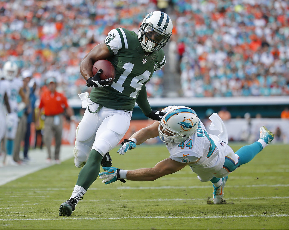 . MIAMI GARDENS, FL - DECEMBER 28:  Wide receiver Chris Owusu #14 of the New York Jets runs enroute to his first quarter touchdown on the play as defensive back Jordan Kovacs #44 of the Miami Dolphins defends during a game at Sun Life Stadium on December 28, 2014 in Miami Gardens, Florida.  (Photo by Chris Trotman/Getty Images)