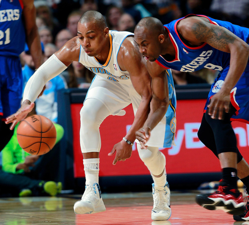 . Denver Nuggets guard Randy Foye, left, pursues a loose ball with Philadelphia 76ers guard James Anderson in the third quarter of the Sixers\' 114-102 victory in an NBA basketball game in Denver on Wednesday, Jan. 1, 2014. (AP Photo/David Zalubowski)