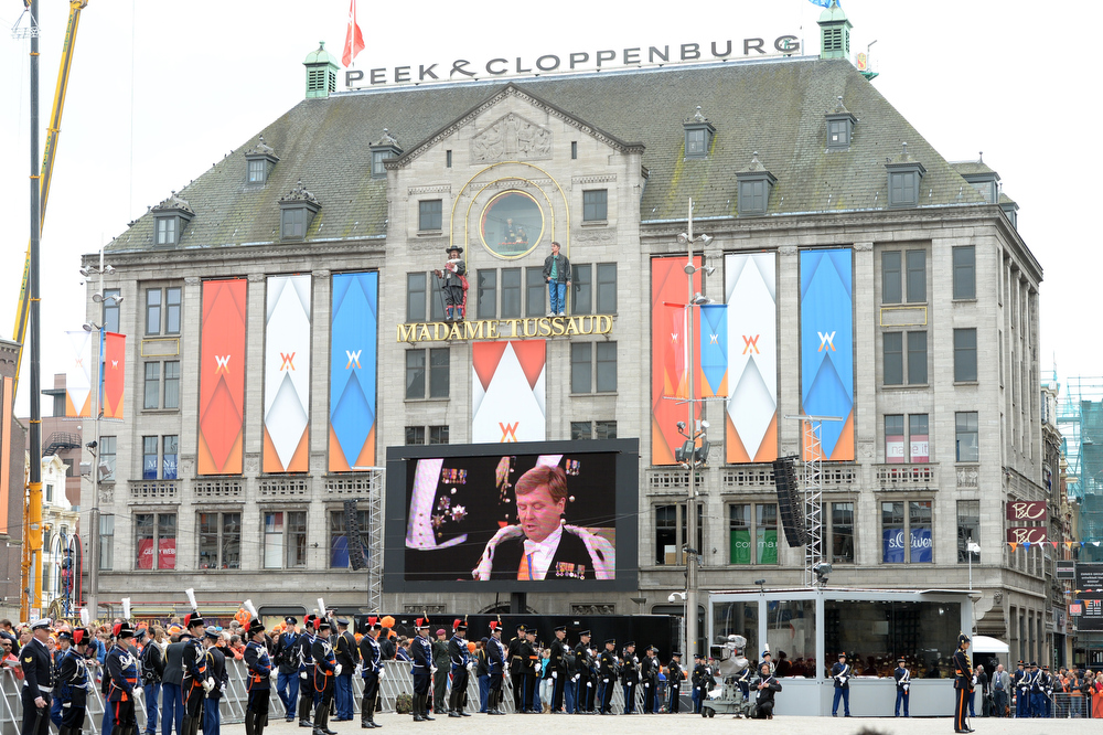 . King Willem-Alexander of the Netherlands is seen on a video screen as he speaks at the Nieuwe Kerk (New Church) in Amsterdam on April 30, 2013.  PATRIK STOLLARZ/AFP/Getty Images