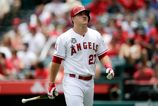 . Los Angeles Angels\' Mike Trout walks off the field after he struck out during the first inning of a baseball game against the Detroit Tigers on Sunday, July 27, 2014, in Anaheim, Calif. (AP Photo/Jae C. Hong)