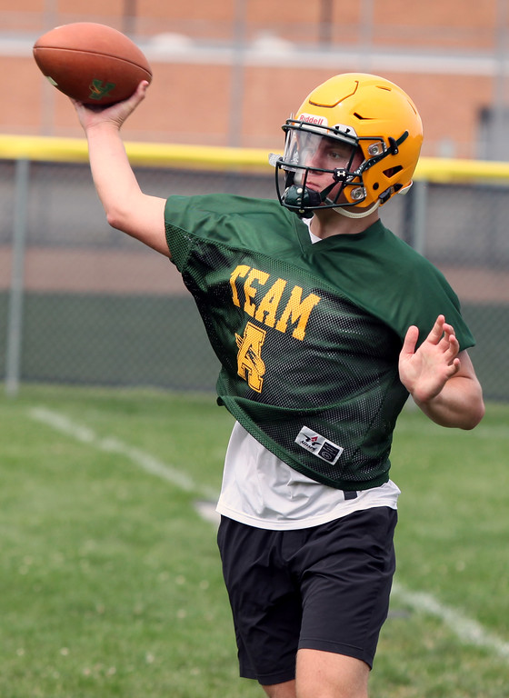 . Randy Meyers - The Morning Journal<br> Amherst quarterback Tyler Brazina runs a roll out and pass drill during Amherst\'s first football practice on July 30.