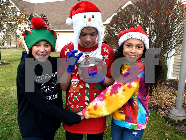 12/2/2017 Mike Orazzi | Staff Elianna Trestman, Corey Lipscomb and Ranada Armour while volunteering during the 24th Annual Breakfast with Santa at Giamatti Little League Center Saturday morning.