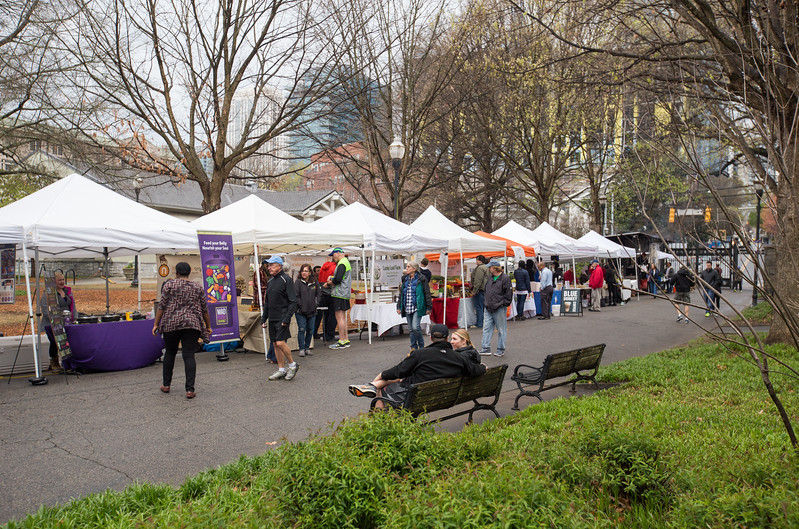 The Green Market in Piedmont Park is open in Midtown every Saturday March through December inside the 12th Street and Piedmont Avenue NE park entrance.  Local farmers, cheese, soap makers, King of Pops, chocolate makers, coffee purveyors and vendors line the path into the park.  (Jenni Girtman / Atlanta Event Photography)