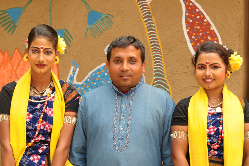Gopal Chandra Mohapatra, Gen. Sec & Principal of Dayal Sangeet Academy, Rasulgarh, Bhubaneshwar, Orissa along with two of the girl performers of Odissi Classical dance and Sambalpuri Folk dance. At the Surajkund Crafts Mela 2009, Haryana, North India.