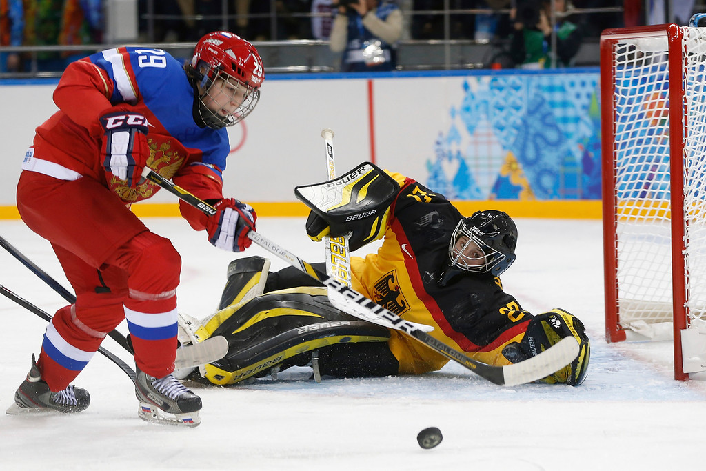 . Goalkeeper Viona Harrer of Germany blocks Anna Shokhina of Russia shot at the goal during the first period of the 2014 Winter Olympics women\'s ice hockey game at Shayba Arena, Sunday, Feb. 9, 2014, in Sochi, Russia. (AP Photo/Petr David Josek)