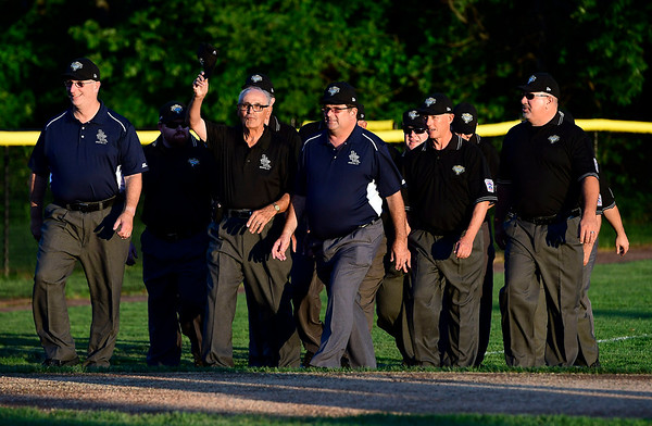 8/4/2018 Mike Orazzi | Staff Umpires take the field during the opening ceremony at The A. Bartlett Giamatti Little League Leadership Training Center Saturday night.