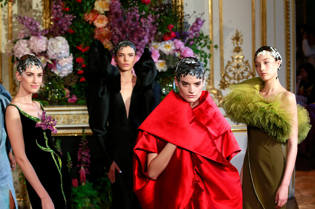 . Models present creations by French designer Alexis Mabille as part of his Haute Couture Fall Winter 2013/2014 fashion show in Paris July 1, 2013.   REUTERS/Gonzalo Fuentes