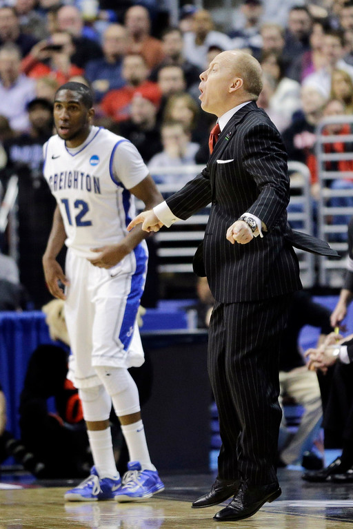 . Cincinnati head coach Mick Cronin yells to his team during the first half of a second-round game against Creighton during the NCAA college basketball tournament, Friday, March 22, 2013, in Philadelphia. (AP Photo/Matt Slocum)