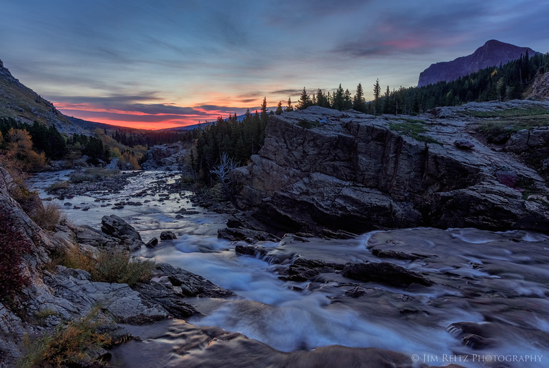 Colorful first light over the Swiftcurrent River, Glacier National Park
