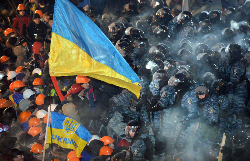 ". Riot policemen clash with protesters on Independence Square in Kiev, on December 11, 2013. Ukrainian security forces on December 11 stormed Kiev\'s Independence Square which protesters have occupied for over a week but the demonstrators defiantly refused to leave and resisted the police in a tense standoff. Eite Berkut anti-riot police and interior ministry special forces moved against the protestors at around 2:00 am (midnight GMT) in a move that prompted US Secretary of State John Kerry to express ""disgust\"" over the crackdown.   SERGEI SUPINSKY/AFP/Getty Images"