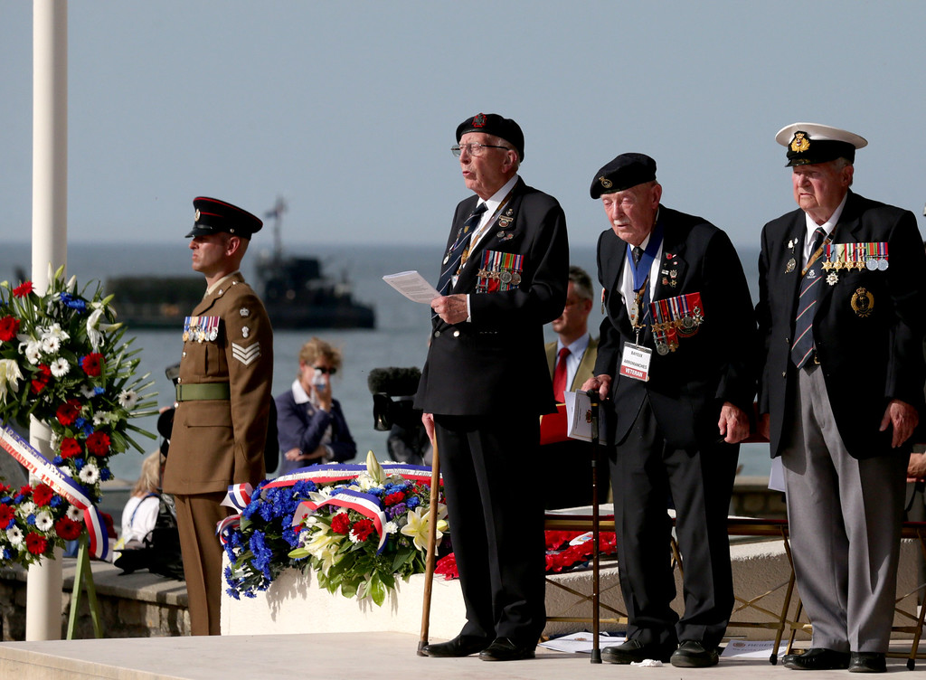 . Normandy veterans attend a parade at Arrowmanches-Les-Bains during D-Day 70 Commemorations on June 6, 2014 near Bayeux, France.  (Photo by Matt Cardy/Getty Images)