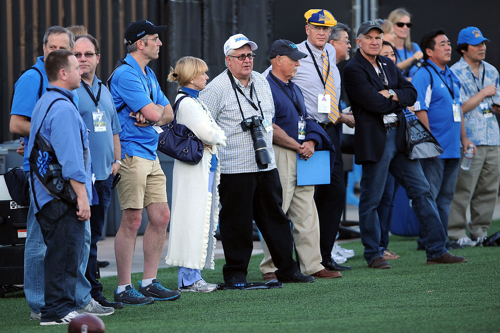 . Football enthusiasts look on during spring practice Monday April 7, 2014 at UCLA.(Andy Holzman/Los Angeles Daily News)