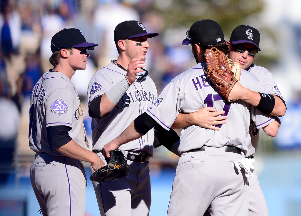 . Rockies\' Todd Helton is hugged by teammates after the last game of a 17 year career at Dodger Stadium during the final game of the regular season Sunday, September 29, 2013. Helton is retiring after 17 seasons. (Photo by Sarah Reingewirtz/Pasadena Star-News)